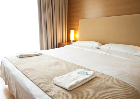 Two hotel bed linens on a bed